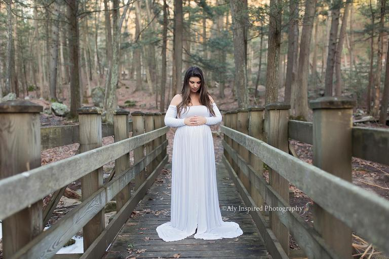 c11fd17b5a278 ... maternity gown featuring an elegant off-shoulder neckline, long  sleeves, and a full maxi-style skirt. Our Miriam has a split front but can  be positioned ...